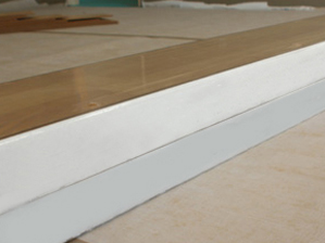 Laminate Installation quarter round trim or a wall base